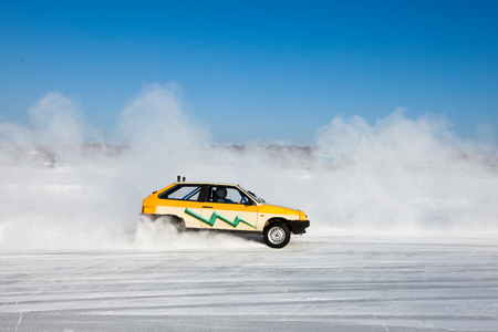 rival rivals rivalry season: A car is taking part in auto ice racing Stock Photo