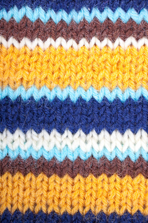 stripped: Stripped knitted background. Blue, white, orange, brown and turquoise