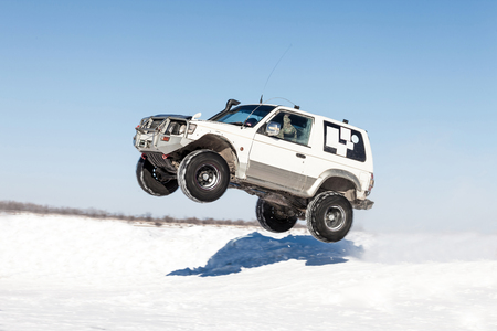 springboard: Mitsubishi Pajero flying after jump from springboard