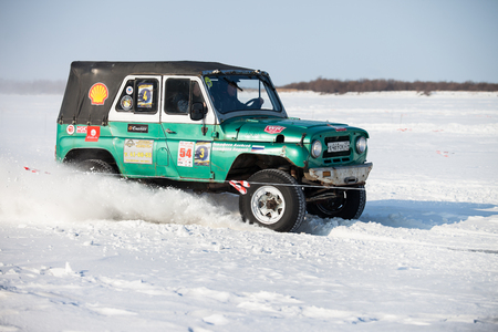 KHABAROVSK, RUSSIA - JANUARY 28, 2017: UAZ 469 riding on snow during local championship
