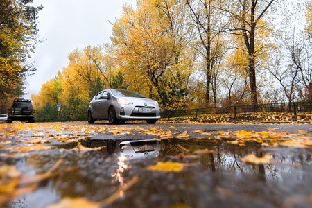 KHABAROVSK, RUSSIA - OCTOBER 14, 2017: Silver Toyota Aqua on autumn road in rainy day