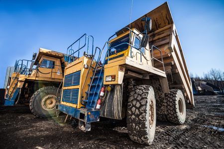 Yellow dump trucks ready to work Standard-Bild - 102770070