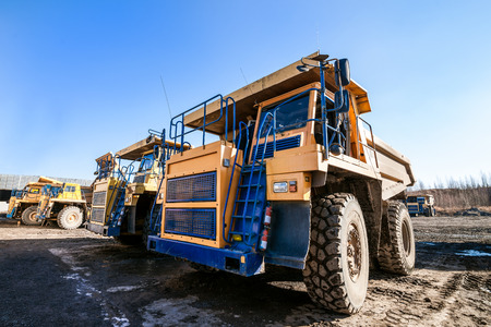 Yellow dump trucks ready to work