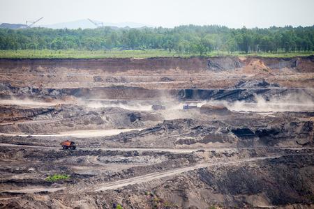 Dump trucks working at open coal mine Standard-Bild - 103874429