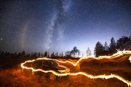 Siberia. Night. Milky way. Black crossover. Sparkler. Standard-Bild - 110545628