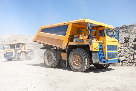 Dump trucks moving in a coal mine