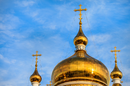 Orthodox cathedral dome and golden cross in Khabarovsk, Russia