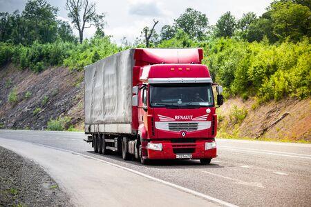 BIKIN, RUSSIA - JUNE 06, 2018: Red Renault trucks moving by a road