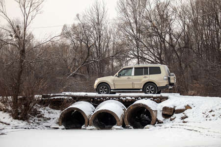 Khabarovsk, Russia - January 7, 2021: Mitsubishi Pajero/Montero at old bridge in winter forest Editöryel