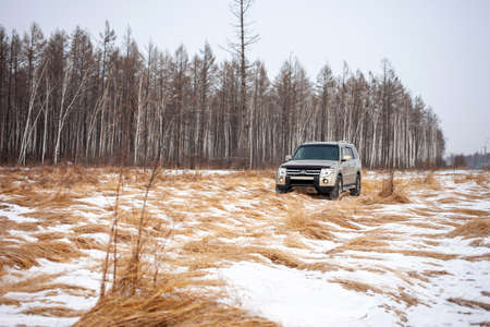 Khabarovsk, Russia - January 7, 2021: Mitsubishi Pajero/Montero at dirt road in winter forest.