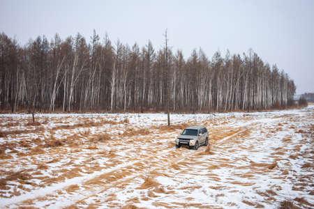 Khabarovsk, Russia - January 7, 2021: Mitsubishi Pajero/Montero at dirt road in winter forest