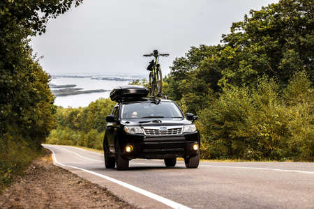 Khabarovsk, Russia - September 07, 2019: Subaru Forester with a bicycle and roof box at roof rack Editöryel