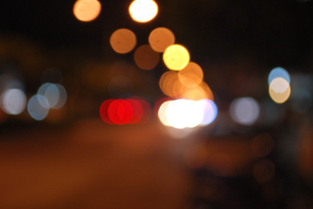 Bokeh images and blurring of street lights and car taillights Фото со стока