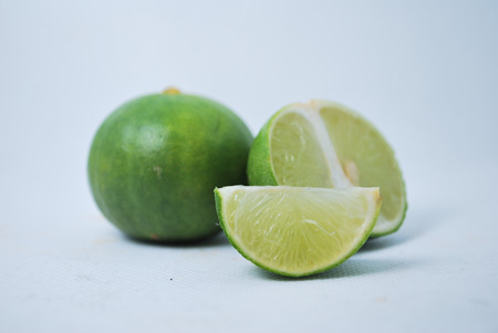 Fresh green lime on a white background