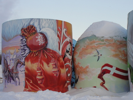 unmatched: Unique Russia. Winter and a half of russian doll. KHARKOV, UKRAINE - WINTER 2017: A half of russian dolls in the snow with Christmas graffiti - closeup.