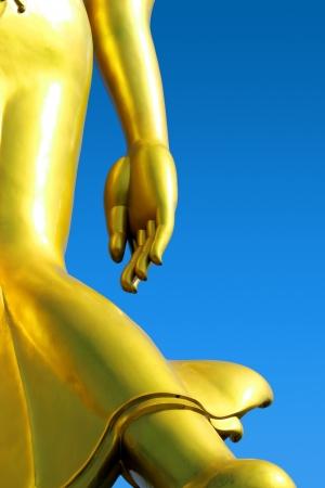 idolatry: Buddha statue with a bright sky background