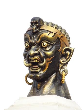 Demon head statue