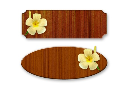 frangipani flower: Wood decorated with frangipani flowers Stock Photo