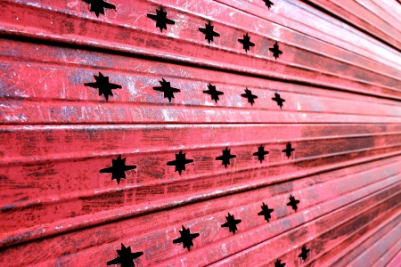 Red zinc with holes. photo