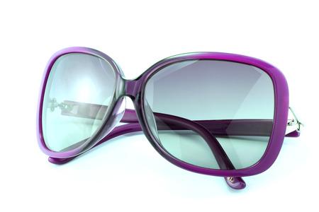 Beautiful sunglasses isolated on white background photo