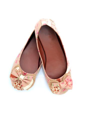 Beautiful womens shoes isolated on white background photo