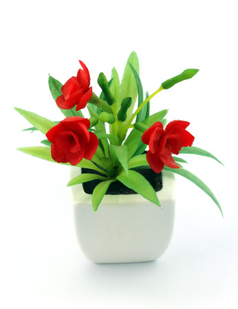 Red Fake Flowers In The Vase On White Background Stock Photo