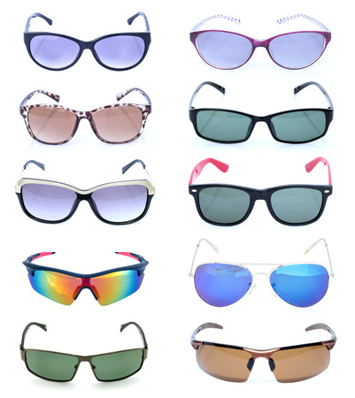Group of beautiful sunglasses isolated on white background photo