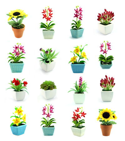 Group of fake flowers in the vase on white background photo