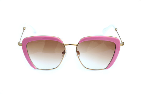 Pink sunglasses isolated on a white background photo