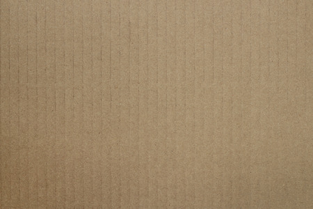 Photo of a brown cardboard background.