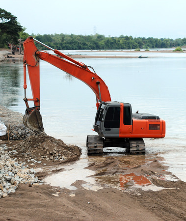 dumper truck: Excavator machine loading dumper truck at river in bantak,Thailand