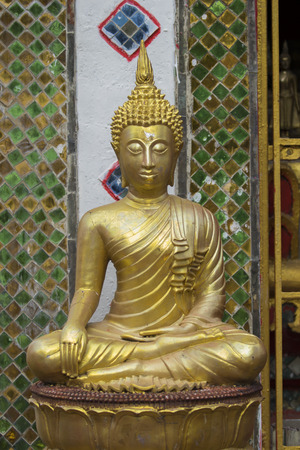godly: Image of golden buddha statue in temple in province tak. Thailand. (Wat Phra Mahathat)