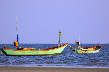 Image of small boat fishing on the sea.