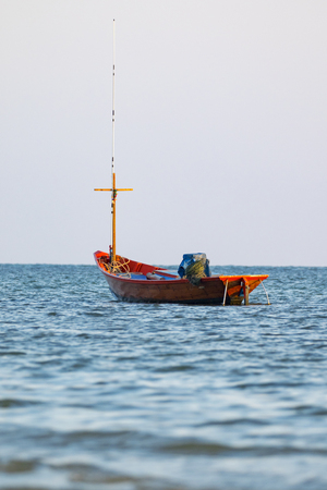 trawler net: Image of small boat fishing on the sea.