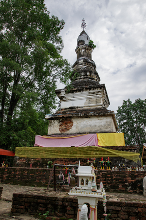 Image of an ancient pagoda is located in the temple in bantak district. Buddhist temple in thailand.