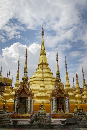 Image of golden pagoda is located in the temple in bantak District. Buddhist temple in Thailand.