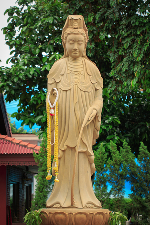 The statue of the Guanyin Boddhisatva on nature background. Religion