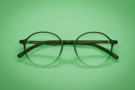 Image of modern fashionable spectacles isolated on green background, Eyewear, Glasses Imagens
