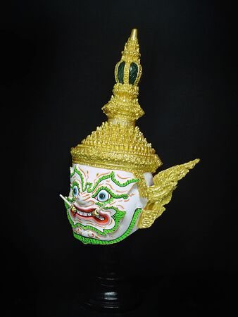 A model of thai actor's Khon mask on black background.(Thai traditional dance) Use in khon thai classical style of ramayana story. Phaichitrasun giant mask in native thai style.