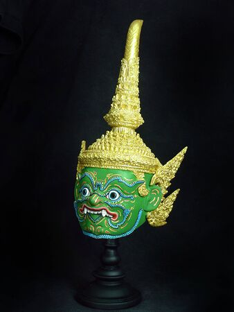 A model of thai actor's Khon mask on black background.(Thai traditional dance) Use in khon thai classical style of ramayana story. Inharachit giant mask in native thai style.