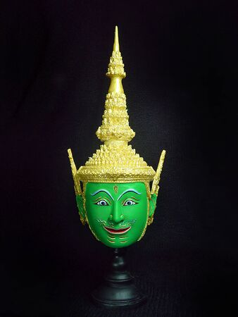 Phra Ram mask incarnation of the god Narai, the hero of the Ramakian. A model of thai actor's Khon mask on black background.(Thai traditional dance) Use in khon thai classical style of ramayana story. Imagens