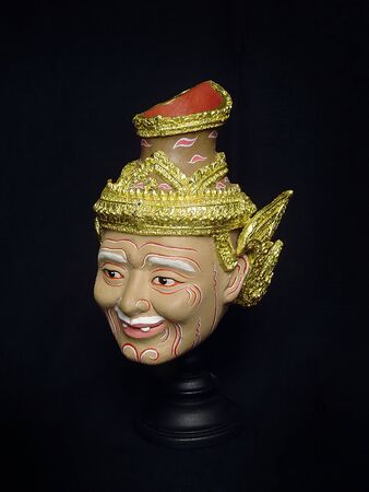 Image of hermit or old father mask in native thai style. A model of thai actor's Khon mask on black background.(Thai traditional dance) Use in khon thai classical style of ramayana story.