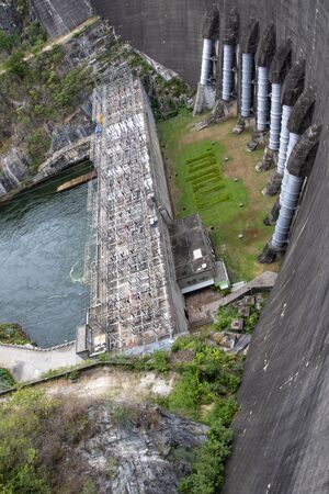 Image of view of bhumibol dam in tak Thailand. Hydro Power Electric Dam and is the first multipurpose dam in thailand and is water storage for agriculture and electricity.. The curved concrete dam. Banco de Imagens
