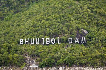 Letter sign of Bhumibol Dam located on the mountain in Tak Province, Thailand.