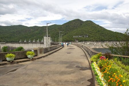 Top of bhumibol Dam in tak thailand. Hydro Power Electric Dam and is the first multipurpose dam in thailand and is water storage for agriculture and electricity.. The curved concrete dam.
