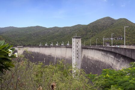 Image of view of bhumibol dam in tak Thailand. Hydro Power Electric Dam and is the first multipurpose dam in thailand and is water storage for agriculture and electricity.. The curved concrete dam.
