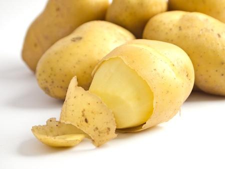 spud: peel potato Stock Photo