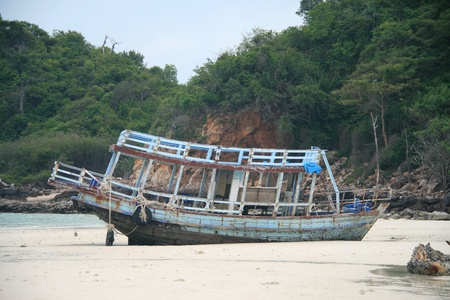 Old boat on beach photo