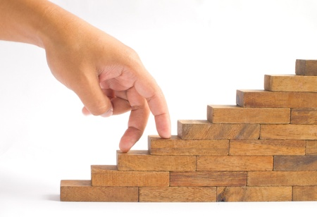 escalera: Mano y escaleras de madera Foto de archivo