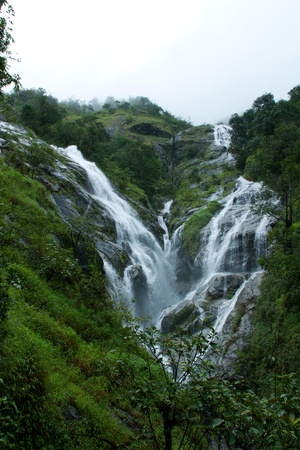 waterfall in the rainforest near border Thailand with Myanmar photo
